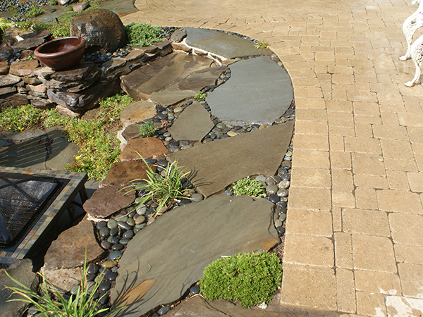 Vista Landscape offers a wide range of hardscapes, including Retaining Walls, Steps, Stone Paths, Brick Paving, Natural Stone Paving, Patios, Walkways, and Driveways.